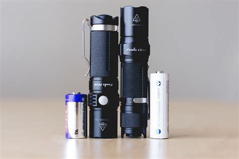 cr123a vs aa choosing the right battery for your edc