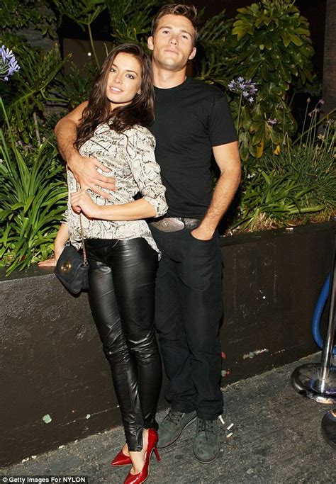 Sorry ladies he s taken scott eastwood and model brittany brousseau