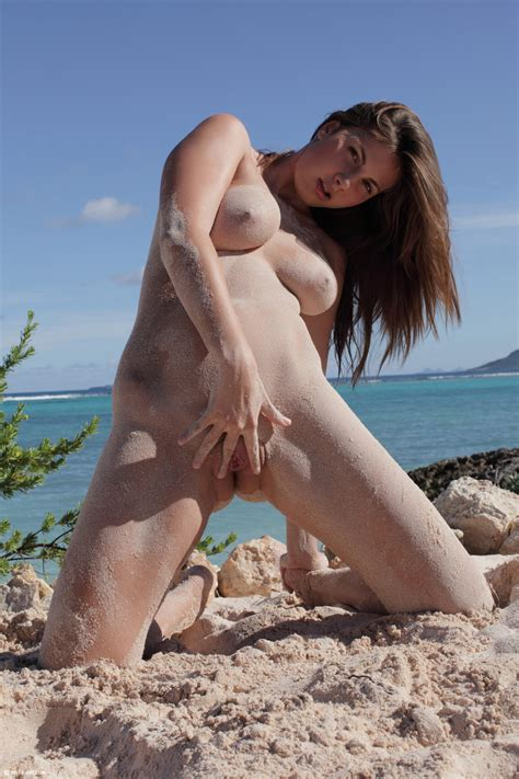 solo girl and exhibitionist at heart poses naked on a