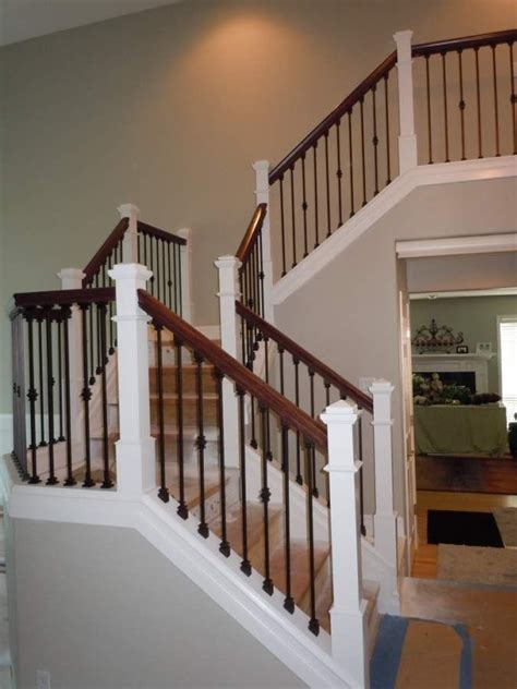 railing rod iron balusters and oak rail