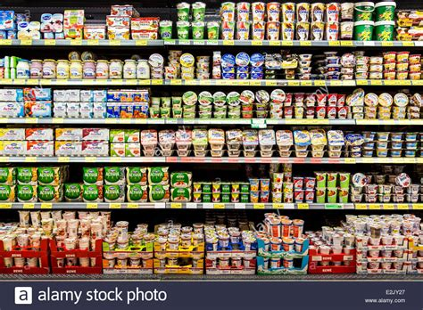 shelf with food in a supermarket milk products yogurt
