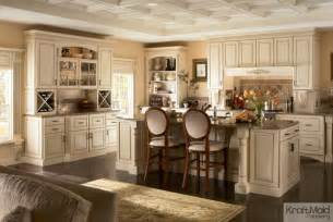 kraftmaid kitchen islands kraftmaid maple cabinetry in biscotti with cocoa glaze