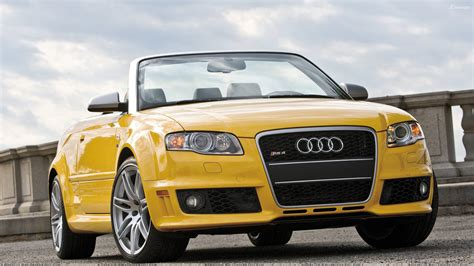 audi rs4 cabriolet front pose in yellow wallpaper