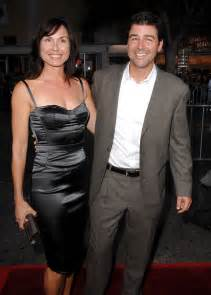 Kyle chandler and wife arrive at the mann s village theatre for the