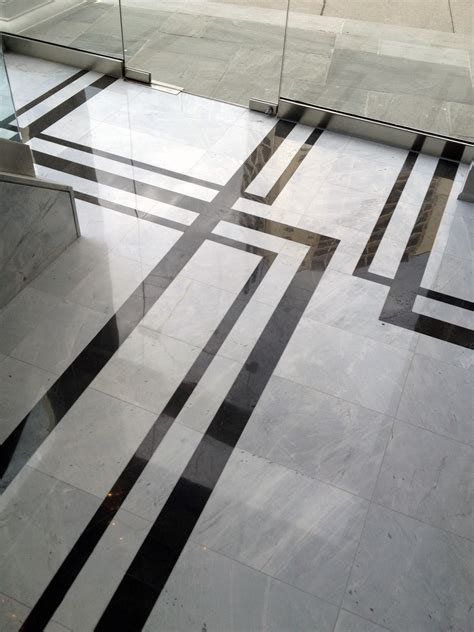 strikingly contrasting marble creates a floor pattern that