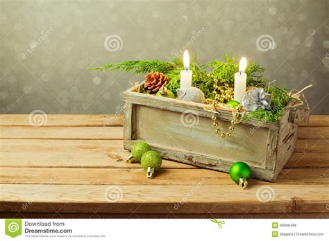 wooden box with christmas decorations and candles over