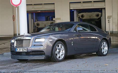 rolls royce sports car rolls royce wraith sport spied wearing massive spoilers