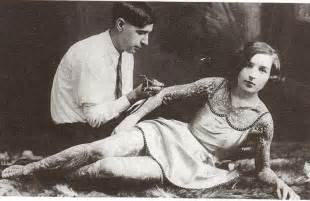 a woman being tattooed early 1900s vintage everyday