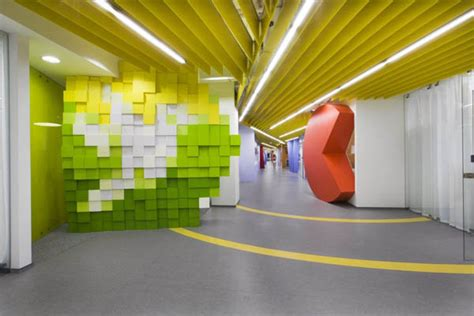 office wall design oversized pixels and brand elements shaping expansive it