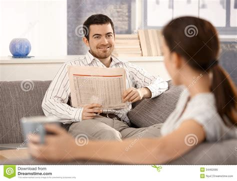 young couple room young couple sitting in living room on sofa royalty free stock photo image 34462095