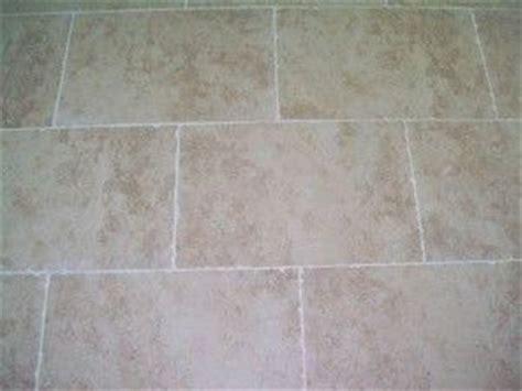 light tan large rectangular floor tile bathroom