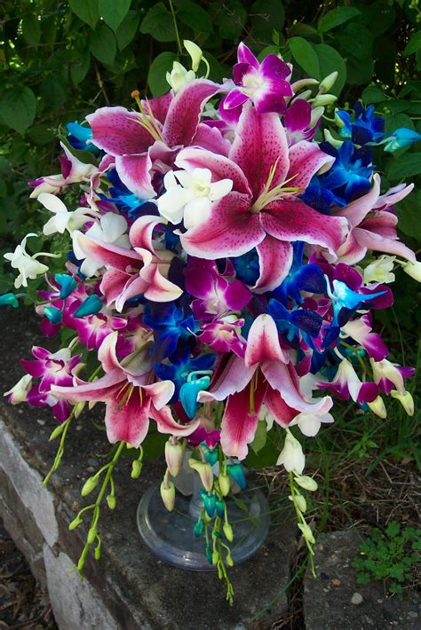 wedding bouquet lilies and orchids carrie powell floral designs something bright blue
