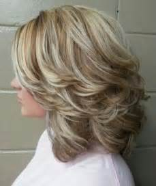 feathered brush back hair layered feathered back hair short hairstyle 2013