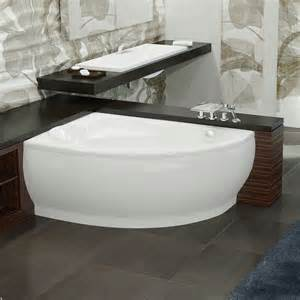 corner curving white tub with silver steel fauce placed on