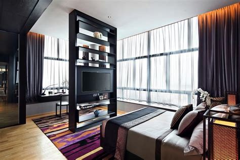 height of tv in bedroom contemporary elegant condominium unit with dark walls