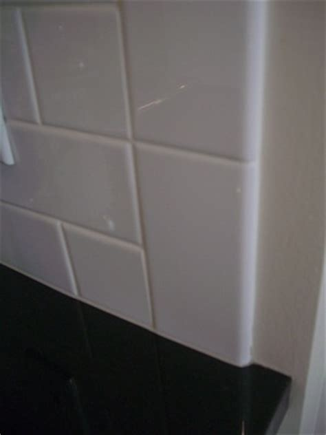 how to finish an edge of tile on a wall