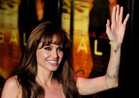 angelina jolie wrist tattoo s 15 tattoos and their meanings bodyartguru