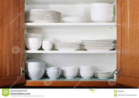 Open Shelf Kitchen Design new white dishes and bowls in kitchen cabinet stock image