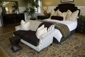 Small Couches For Bedrooms like the above bedroom this one places the loveseat at the foot of