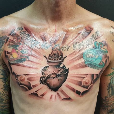 heart tattoos on chest for men nothing is forgotten sacred on chest