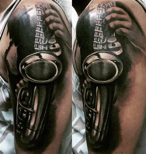 tattoo arm gets bigger 3d like big black and white sax tattoo on arm