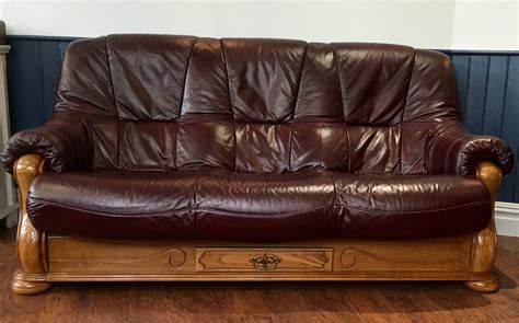 leather and wood sofa burgundy leather 3 seat sofa and reclining chair