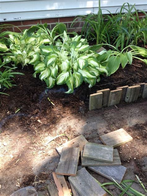diy pallet flower bed pallet wood cut in pieces make a great flower bed