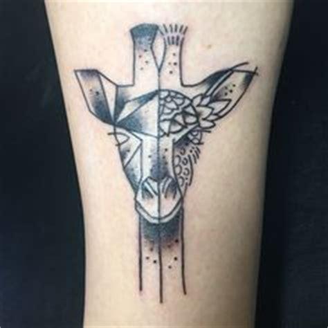 geometric giraffe tattoo 35 delightful tricep tattoo ideas giraffe tattoos
