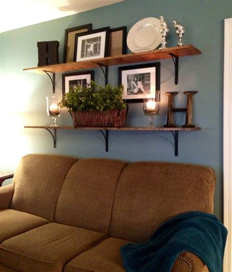 shelves over sofa 1000 ideas about above couch on pinterest shelves above