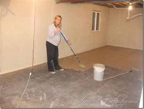 Painting an Unfinished Basement  so easy, a pregnant woman