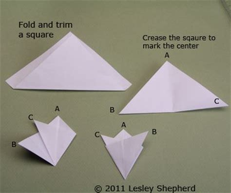 Folding Paper For A Snowflake - make simple winter trees from cut paper snowflakes