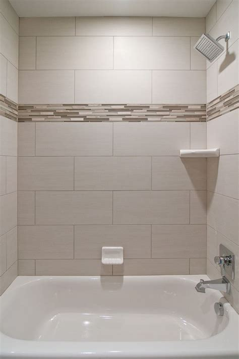 Subway Tile Bathroom Designs We Oversized Subway Tiles In This Bathroom The Addition Of Glass Accent Tiles Gives The