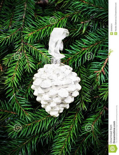 christmas ornaments on fir tree background white