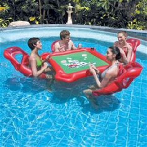 swimming pool furniture on floating table in