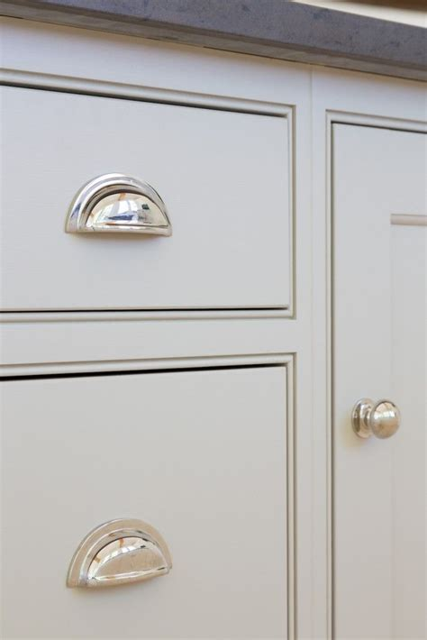 Grey Kitchen Cabinetry And Polished Nickel Handles At The Door Handles Kitchen Cabinets