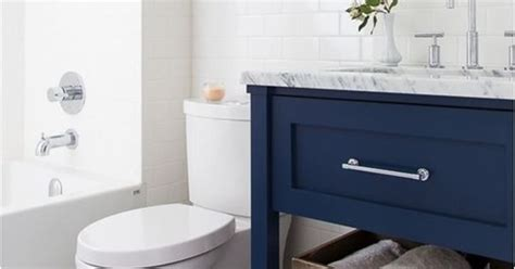 navy blue bathroom vanity the navy blue w the marble floors also herringbone