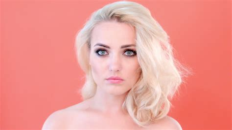 wide shoulders hair beautiful young woman with her long blond hair in curlers