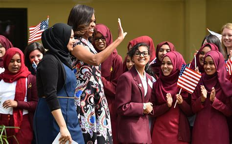 michelle obama in london michelle obama hugs pupils on visit to east london school