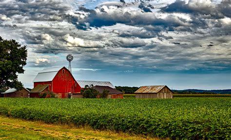 farmhouse ranch houses in farm against cloudy sky 183 free stock photo