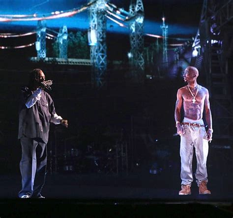 tupac at coachella rapper comes alive via hologram to video tupac resurrected during snoop dogg s performance