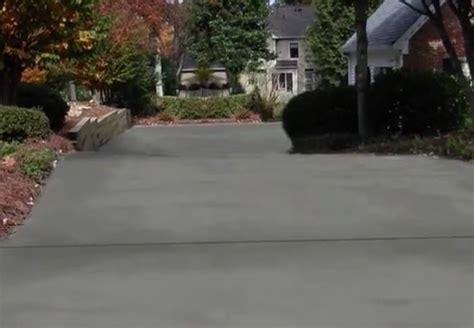 How To Refinish Concrete Patio by How To Resurface A Concrete Driveway Bob Vila