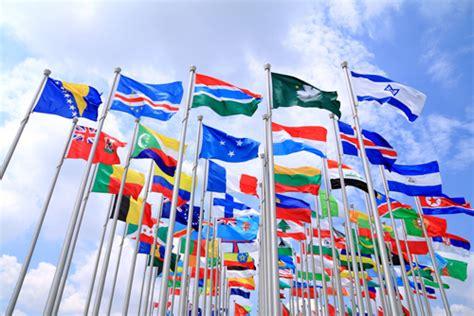 flags of the world waving urge your senators to ratify international disability
