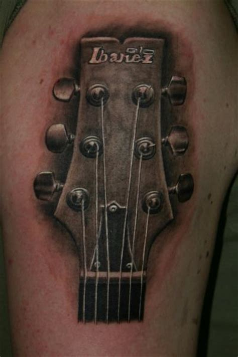 realistic guitar tattoo by corpus del ars