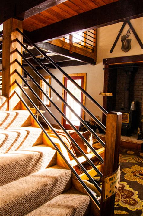 Split Level Entry serene lakes cabin rustic staircase other by j