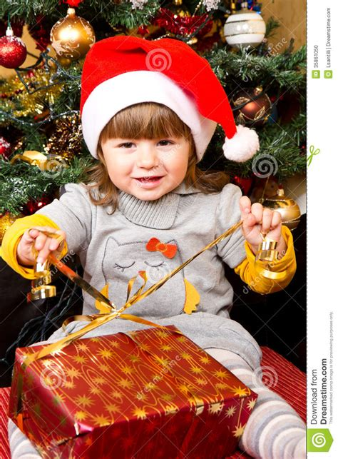 santa hat music box happy child in santa hat opening gift box stock photo image 35861050