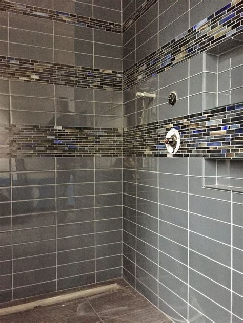 4x12 glass tile with glass accent band around shower