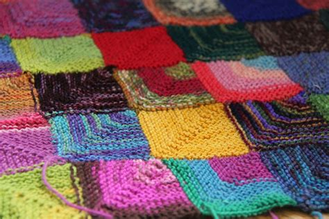 how to do a yarn in knitting sock yarn blanket progress report sea green and sapphire