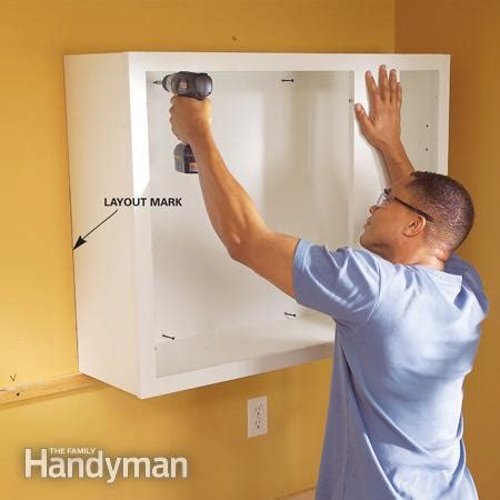 how to install upper kitchen cabinets installing kitchen cabinets the family handyman