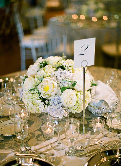 white rose and blue hydrangea centerpiece blue hydrangea