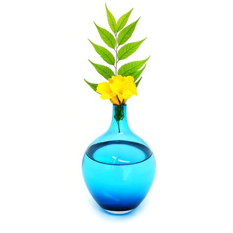 Yellow Flower Vase by Blue Vase With Yellow Flowers Photograph By Lerman